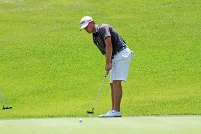 Taylor Moore of Edmond, OK rolls a putt during the third round of the 2013 Western Amateur at The Alotian Club in Roland, AR. (WGA Photo/Ian Yelton)