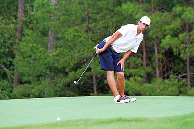 Seth Reeves of Suwanee, GA waits in anticipation as his putt nears the hole during the second round of the 2013 Western Amateur at The Alotian Club in Roland, AR. (WGA Photo/Ian Yelton)