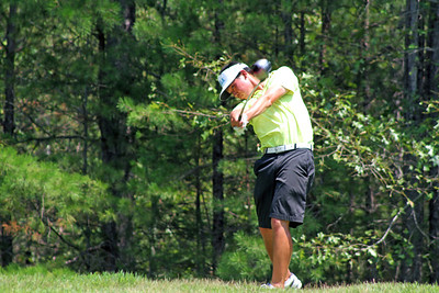 Lorens Chan of Honolulu, HI peeks down the fairway that his ball would eventually land on during the third round of the 2013 Western Amateur at The Alotian Club in Roland, AR. (WGA Photo/Ian Yelton)