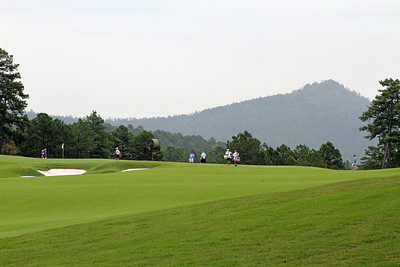 It may not look like much, but those players are far away. The green covered mountain in the background is even farther. Just one of the many captivating views throughout The Alotian Club in Roland, AR. (WGA Photo/Ian Yelton)