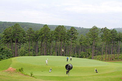 Players look to navigate one of the more difficult greens on the front nine at The Alotian Club in Roland, AR during the opening round of the 2013 Western Amateur. (WGA Photo/Ian Yelton)