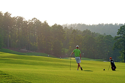 Jordan Niebrugge of Mequon, WI waits for the players in the group ahead of him to clear the green as the sun sets over the trees during the second round of the 111th Western Amateur at the Alotian Club in Roland, AR. (WGA Photo/Ian Yelton)