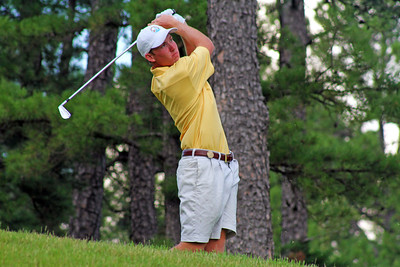 Robby Shelton IV of Wilmer, AL watches his tee shot from the sixth hole fall more than 150 feet to the green during the second round of the 2013 Western Amateur at The Alotian Club in Roland, AR. (WGA Photo/Ian Yelton)
