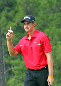 Patrick Rodgers of Avon, IN acknowledges the crowd on his way to earning medalist honors at the 2013 Western Amateur at The Alotian Club in Roland, AR. (WGA Photo/Gary Holaway)