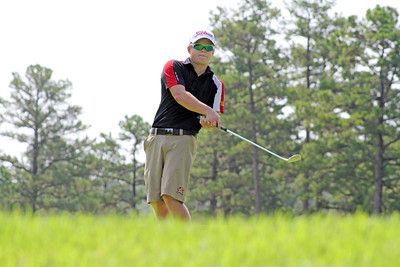 Sean Bosdoch from Clarksburg, MD maneuvers how he wants his putt to during the second round of the 2013 Western Amateur at The Alotian Club in Roland, AR. (WGA Photo/Ian Yelton)