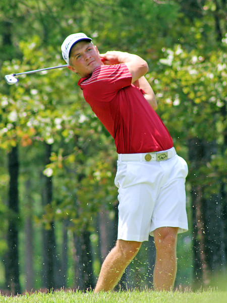 Sebastian Cappelen of Odense, Denmark tees off on the fourth hole during the third round of the 2013 Western Amateur at The Alotian Club in Roland, AR. (WGA Photo/Ian Yelton)
