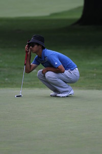 Zecheng Dou of China lines up a putt during the 2014 Western Amateur.