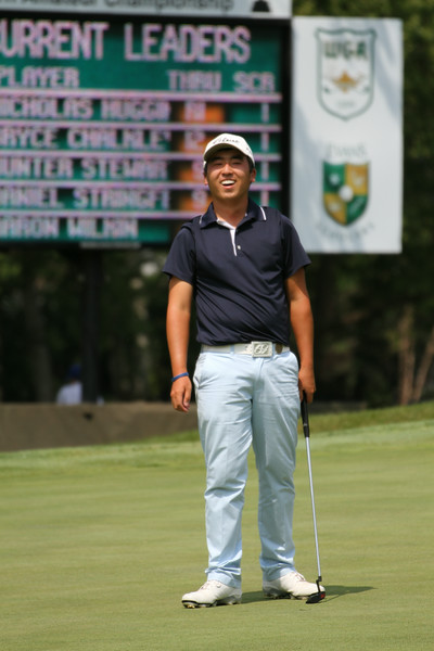 Doug Ghim reacts to sinking a birdie putt that helped the Arlington Heights resident break the Beverly course record set by Tom Weiskopf in 1967.