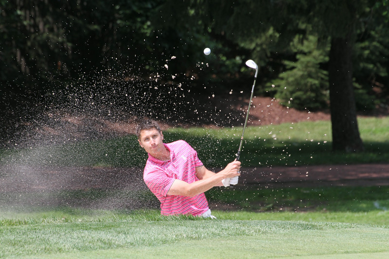 Dave Lubnik hits a shot from the bunker during the first round of the 2014 Western Amateur.
