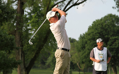 Benjamin Skogen, Onalaska, Wis., tees off in the first round.