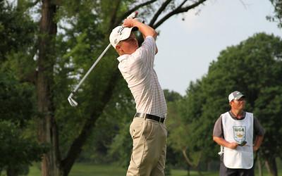 Benjamin Skogen, Onalaska, Wis., tees off in the first round.