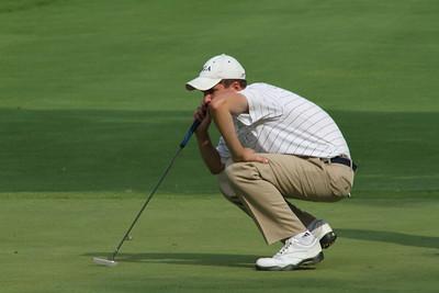 Junior golfer Geoff Vartelas, Cromwell, Conn., lines up a putt.