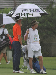 Western Junior players had to cope with rain early Wednesday before the weather finally forced a suspension of play.