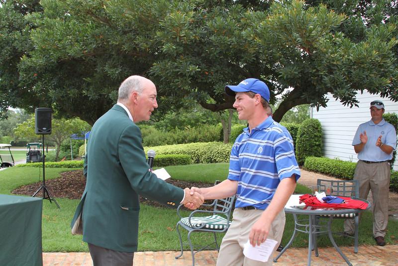 Western Golf Association Chairman Jim Bunch congratulates Adam Wood, 2012 Western Junior champion.