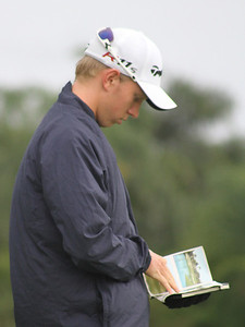 First round leader Jimmy Stanger looks over his yardage book early in second round play.