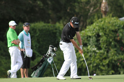 Emilio Maurer, one of the international competitors from Mexico, makes solid contact with a mid range iron.