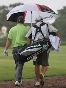 Heavy rain has caused a suspension in play in Wednesday's second round of the 2012 Western Junior at the Country Club of Florida.