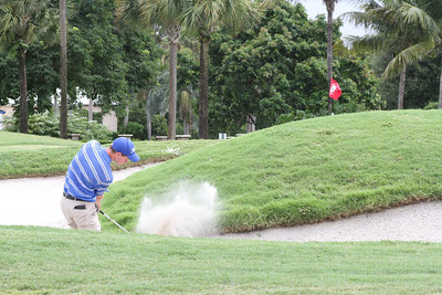 Adam Wood sprays a shot out of the sand on the 8th hole.