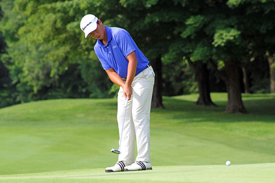 Andy Zhang of Reunion, Fla. rolls a putt towards the cup during the third round of the 96th Western Junior at Meridian Hills Country Club.