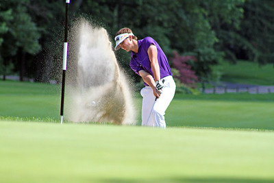 Second round leader Will Gordon of Davidson, N.C., blasts a shot out of the pot bunker in front of the 17th green at Meridian Hills Country Club during the 96th Western Junior. (WGA Photo/Ian Yelton)