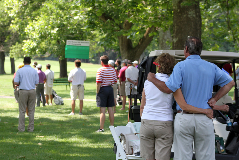 Fans watch eagerly as the third round's final group hit their tee shots on the 16th tee during the third round of the 96th Western Junior at Meridian Hills Country Club.