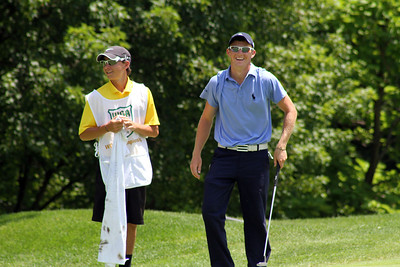A junior and his caddy share a laugh walking up to the putting green during the first round of the 96th Western Junior at Meridian Hills Country Club. (WGA Photo/Ian Yelton)