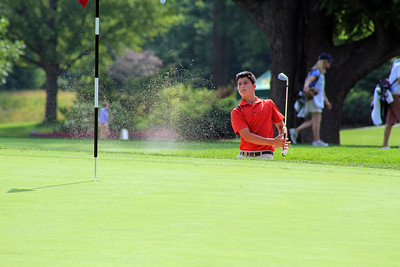Gordon Neale of Dove Canyon, Calif., tries to save par from the green-side bunker on the 13th hole during the third round of the 96th Western Junior at Meridian Hills Country Club.