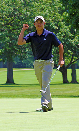 Collin Morikawa of La Canada Flintridge, Calif., gives the gallery a fist pump after draining a 25-foot birdie putt ono the 72nd hole of the 96th Western Junior at Meridian Hills Country Club. He won the championship by five strokes.