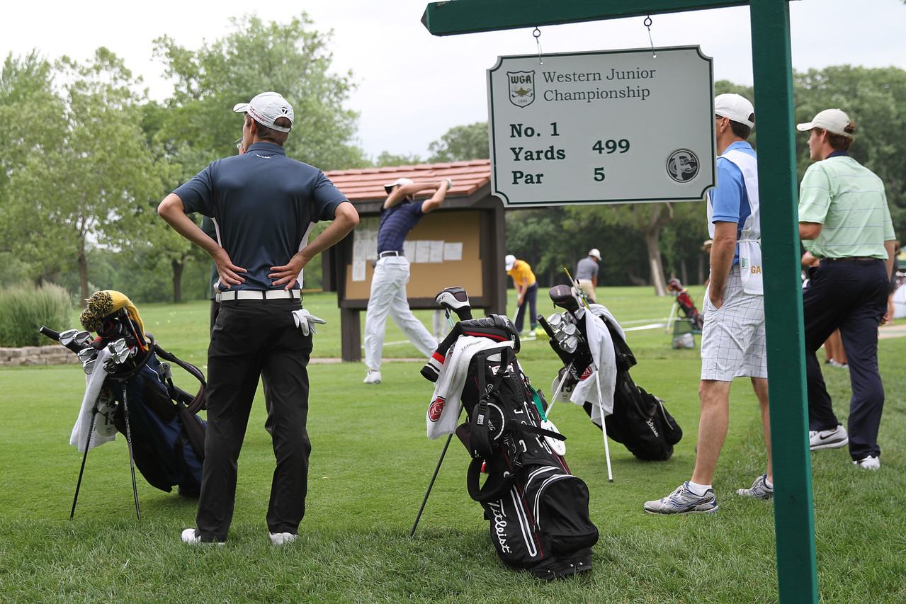 Players gather to watch Steven DiLisio of Swampscott, MA tee off during the first round of the 2014 Western Junior Championship.