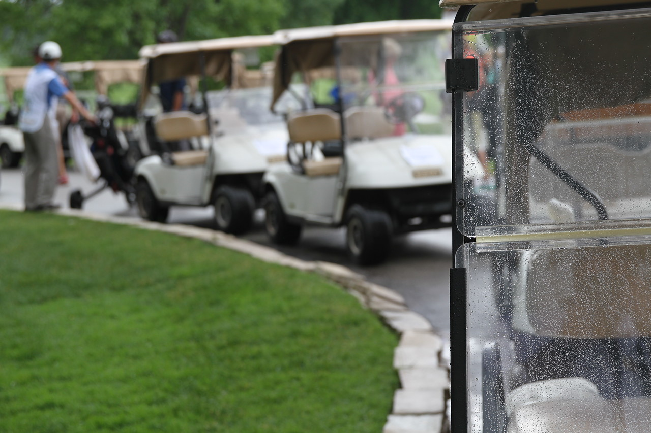 Golf carts line up to shuttle players back to their holes after a rain delay during the second round of the 2014 Western Junior Championship.