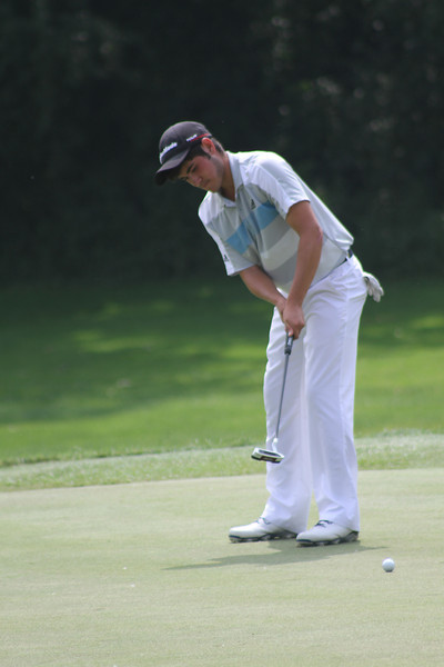 Luis Gagne putts on no. 18. Gagne's two-under 66 broke the Wilson Furr's hours-old record by a stroke.