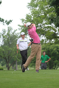 Jack Mulligan of Flossmoor, Illinois tees off during the first round of the 2014 Western Junior Championship.