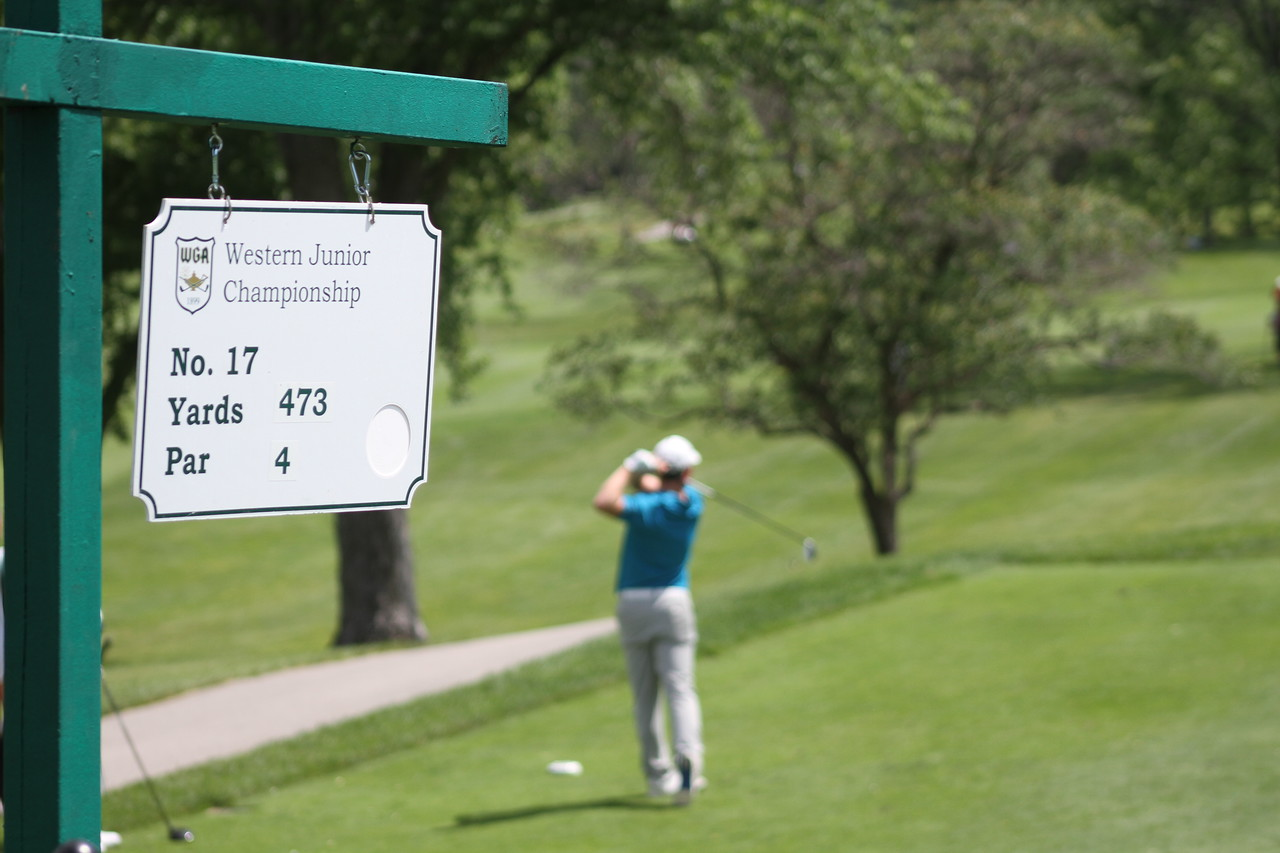 A junior tees off on the 17th hole during the first hole of the 2014 Western Junior Championship.