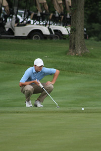 Sam Burns of Shreveport, Louisiana lines up a putt during the first round of the 2014 Western Junior Championship.