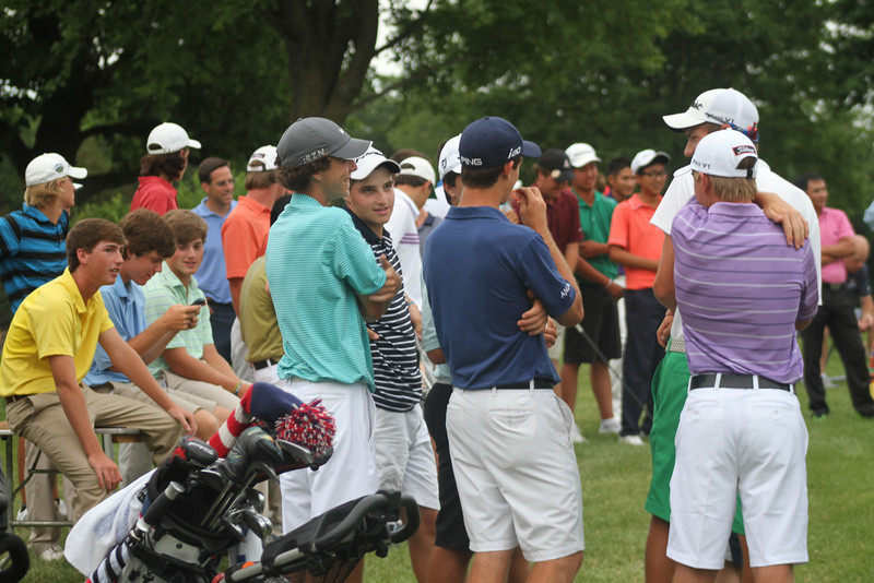 Players gather outside the clubhouse before the Long Drive Contest following the players' banquet Monday night.