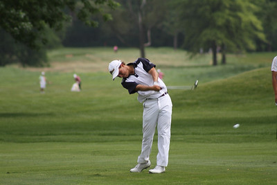 Jack Comstock of Jacksonville, Florida hits a shot from the fairway during the second round of the 2014 Western Junior Championship.