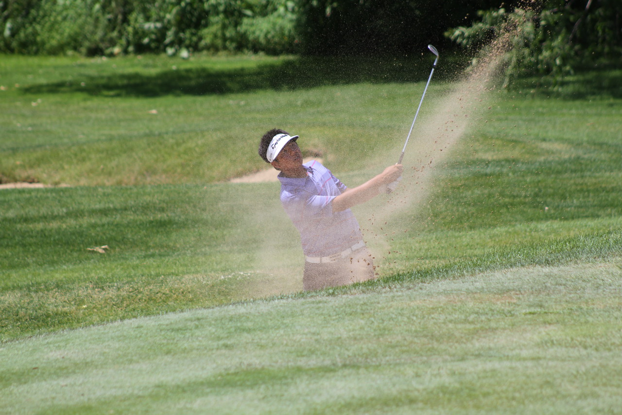 KK Limbhasut of Loma Linda, California hits out of the bunker on the 18th hole at the 2014 Western Junior Championship.