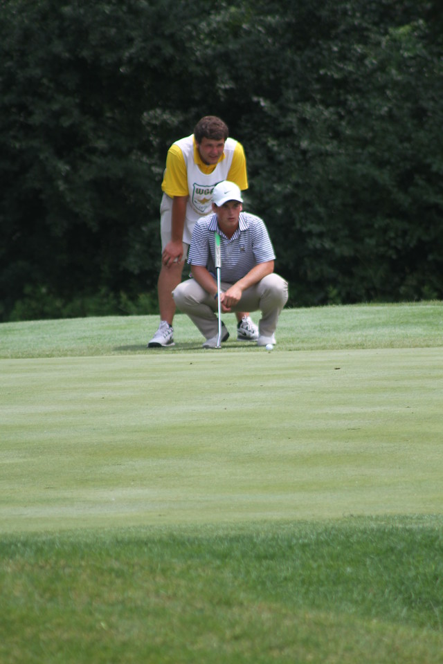 Wilson Furr, of Jackson, Mississippi, lines up a putt on the 9th green during the third round of the 2014 Western Junior Championship. Furr's one-under 67 broke, what was then, the Flossmoor course record of 68.
