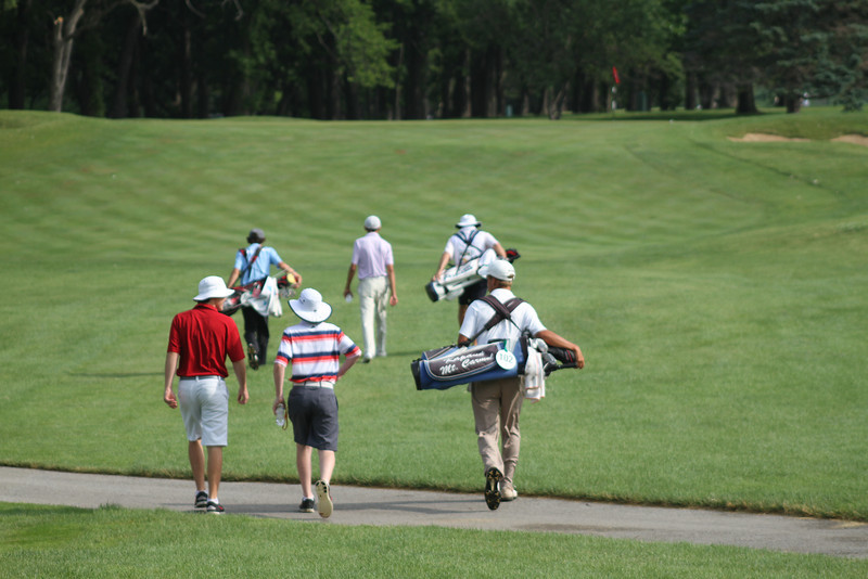 A group, including then-tournament leader Daniel Wetterich, walks up the 18th fairway during the second round of the 2014 Western Junior Championship.