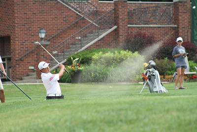 Collin Morikawa hits out of the bunker on the 18th hole during the 2014 Western Junior Championship.