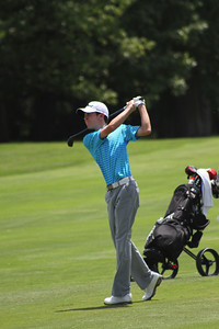 Will Grimmer of Cincinnati, Ohio, who qualified to play in the 2014 U.S. Open, hits a fairway shot during the 2014 Western Junior Championship.