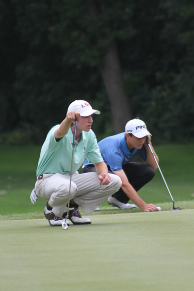 Philip Barbaree and Dawson Armstrong line up their putts during the second round of the 2014 Western Junior Championship.