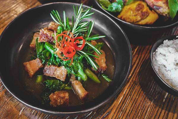 Sautéed Chinese broccoli with crispy pork