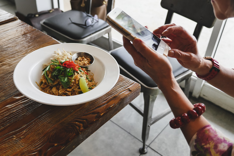 Wok Star taking a picture of pad thai