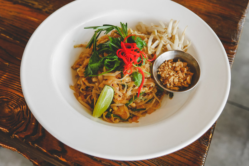 Chicken Pad Thai - Sautéed rice noodles with egg, bean sprouts, chives, peanuts