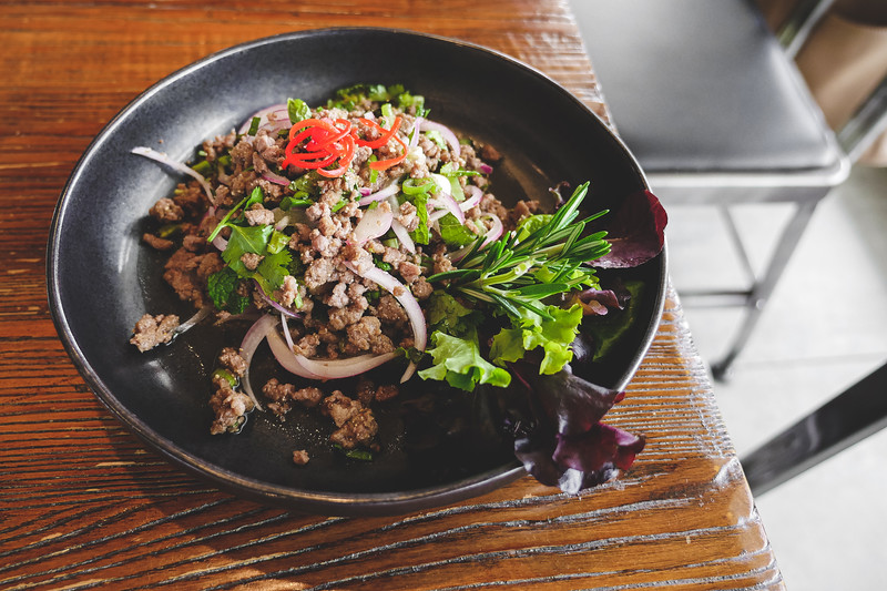 Larb - ground meat with fresh mints, scallions, toasted rice powder, dried chilies and lime juice