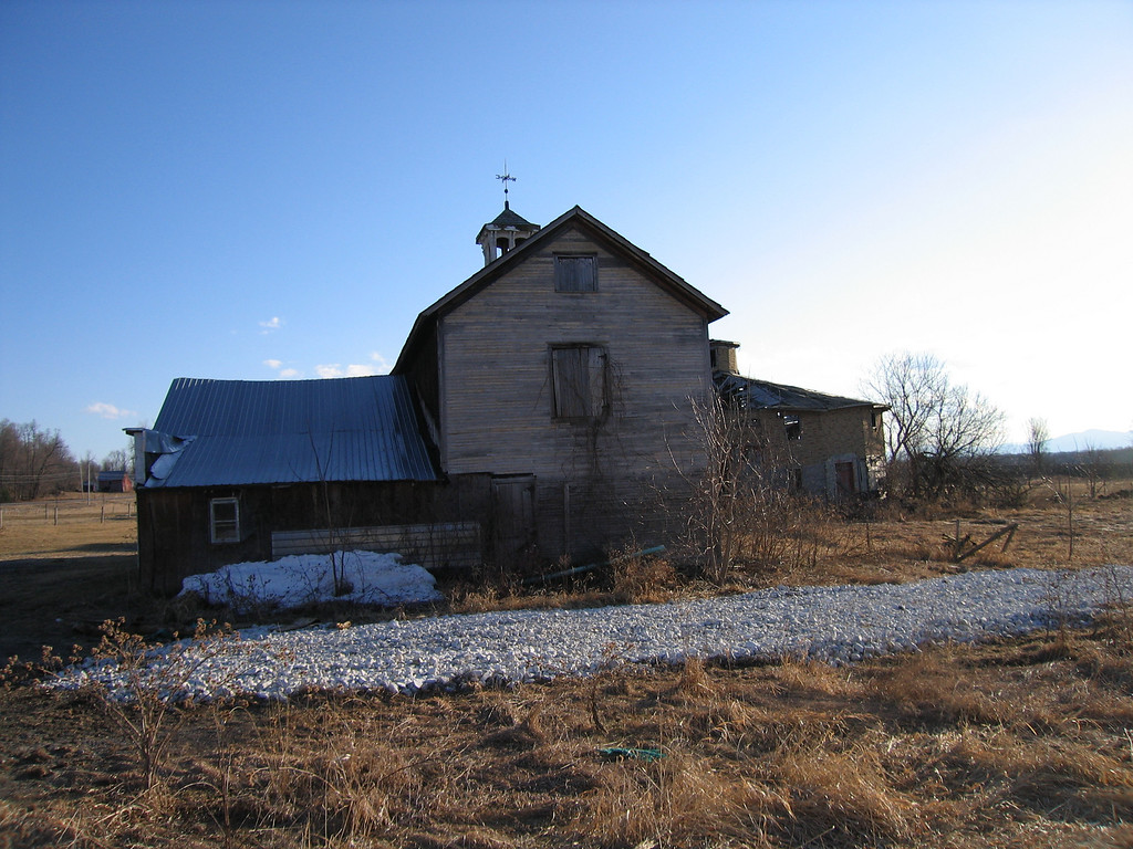 14 Horse Barn with Round Barn in Background