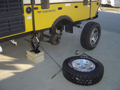 Remove flat tire and replace it with the spare