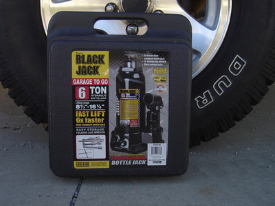 Locate jack and lug tool (under spare in truck, under seat, under hood or in tool box))