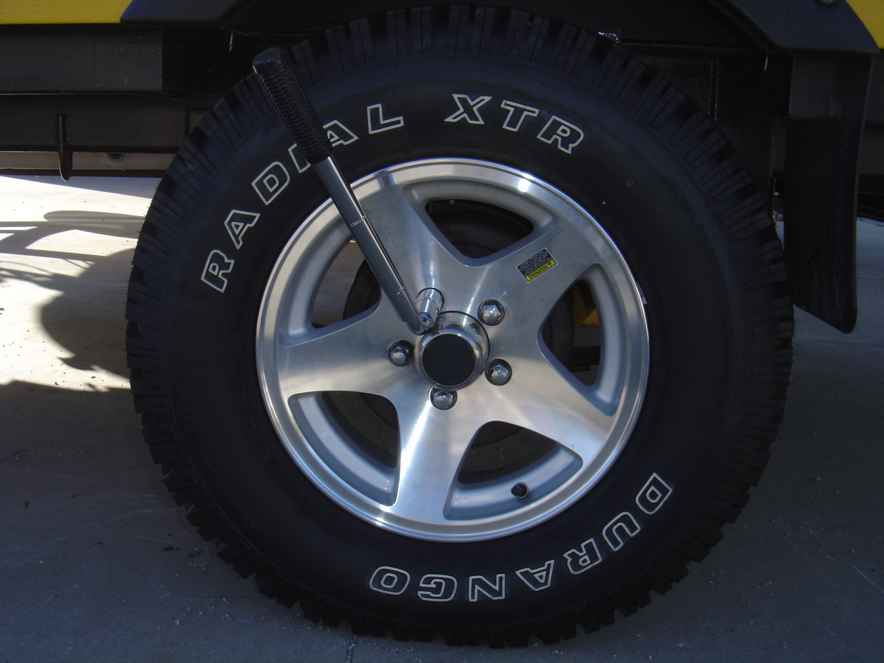 Loosen Lug nuts of the flat tire but do not remove them